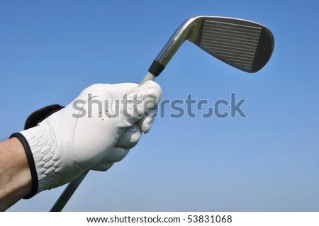 Golfer Wearing a Golf Glove Holding an Iron (Golf Club)