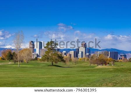 Golfers at City Park Golf Course with Denver Skyline