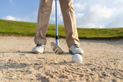 Golfers get ready to exploding sand in the bunker. Outdoor sports and recreation Concept.