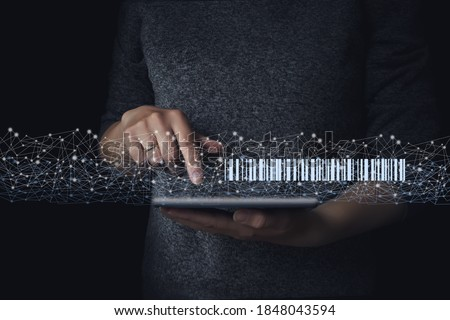 Photo of  Gologram barcode scan on tablet in hand, warehouse and logistics. Home delivery service. Modern warehouse management technology businesses