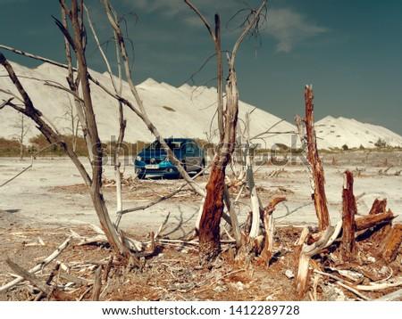 GOMEL, BELARUS - MAY 29, 2019: Blue Renault Logan car in lifeless desert. #1412289728