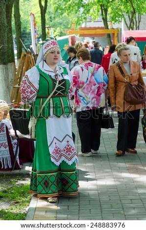 GOMEL, BELARUS - MAY 16, 2014: Outdoor events City Wizards. Woman in Belorussian suit