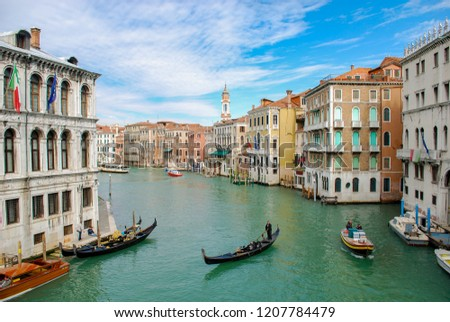 Gondola and a motor boat on the Grand Canal in Venice Italy #1207784479