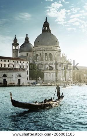 Gondola and Basilica Santa Maria della Salute, Venice, Italy #286881185