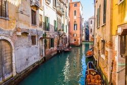 Gondola boat in beautiful canal, Venice, Italy
