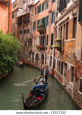 Gondola in a canal in Venice, Italy