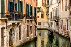 Gondola in picturesque Venice Canal - Venice, Italy