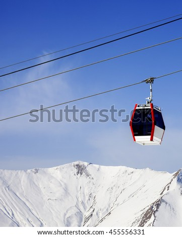 Gondola lift and snowy mountains at ski resort. Caucasus Mountains, Georgia, region Gudauri. #455556331