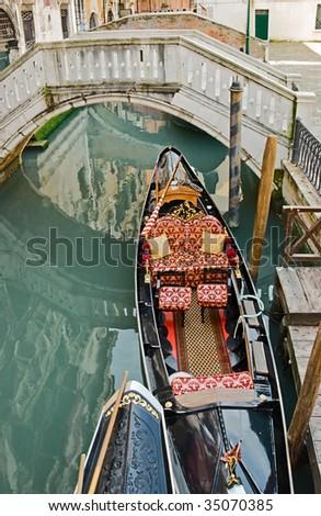 Gondola near bridge, Venice, Italy.