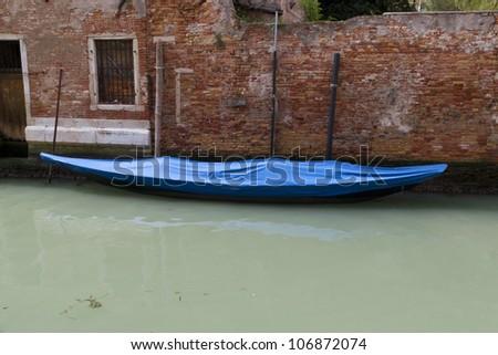 Gondola near old building in Venice, Italy