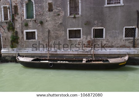 Gondola near old building in Venice, Italy