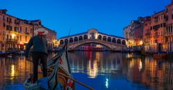 Gondola near Rialto Bridge at twilight blue hour - Venice, Italy