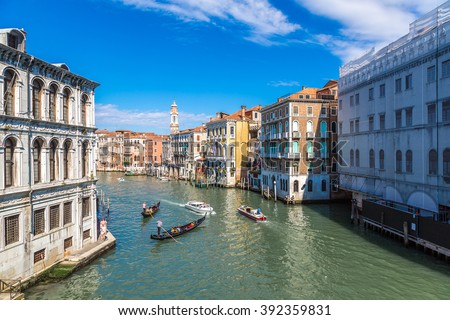 Gondola on Canal Grande in Venice, in a beautiful summer day in Italy #392359831
