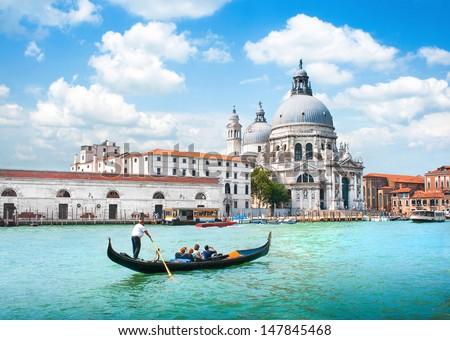 Gondola on Canal Grande with Basilica di Santa Maria della Salute in the background, Venice, Italy #147845468