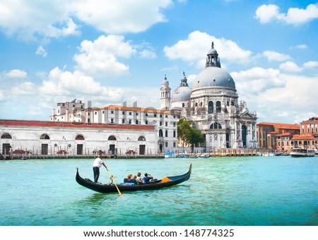 Gondola on Canal Grande with Basilica di Santa Maria della Salute in the background, Venice, Italy #148774325