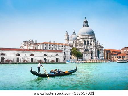 Gondola on Canal Grande with Basilica di Santa Maria della Salute in the background, Venice, Italy #150617801