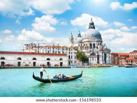 Gondola on Canal Grande with Basilica di Santa Maria della Salute in the background, Venice, Italy #156198533