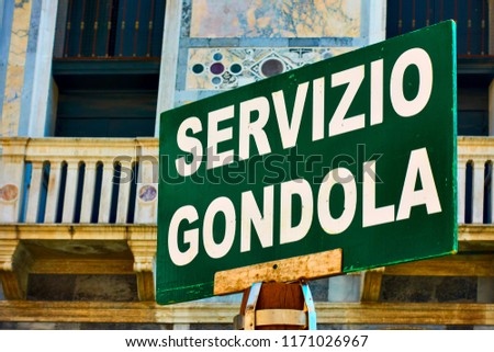 Gondola service sign on a pole in Venice, Italy (Servizio Gondola it. - Gondola service, point where tourists can take gondola)