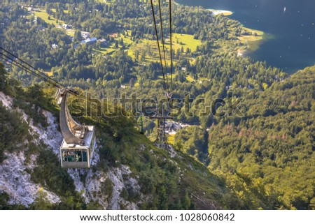 Gondola ski lift in summer taking hikers into the mountains of Vogel area in Triglav National Park near Bled, Slovenia Stockfoto ©