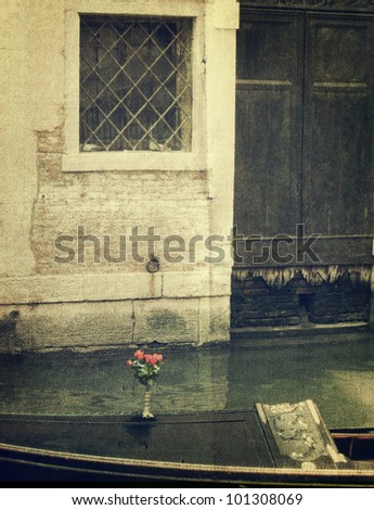 Gondola with bunch of red rose. Venice. Old style image