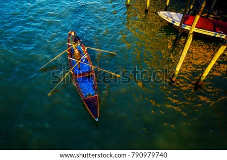 Gondola with man  and  woman . Gondola with man  and  woman .  they themselves are controlled with oars. VENICE , ITALY. FEBRUARY 23,   2014 - Shutterstock ID 790979740