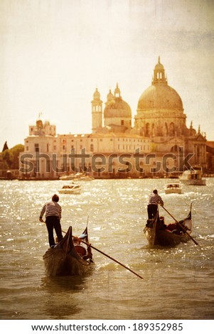 Gondolas and sunset in front of Santa Maria Della Salute Venice Italy in old-fashioned dreamy style
