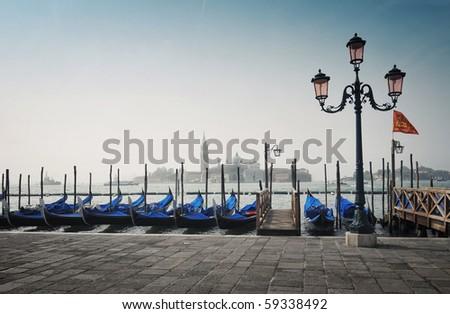 Gondolas and the San Giorgio Maggiore church at background in Venice - Italy #59338492