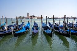 Gondolas at the Piazzetta San Marco in Venice with San Giorgio Maggiore in the back