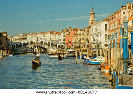 Gondolas crossing on Canal Grande, near Ponte Rialto, in Venice, Italy