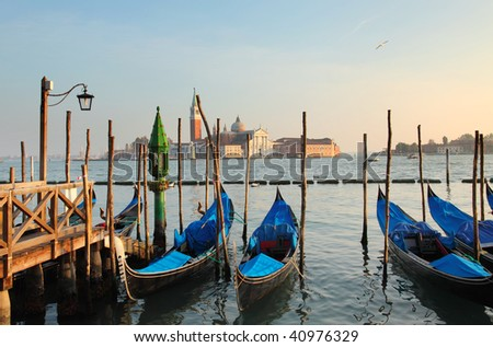Gondolas in Venice at sunset - stock photo