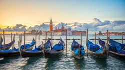 Gondolas moored by Saint Mark square with San Giorgio di Maggiore church in Venice, Italy,16:9 Ratio
