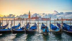 Gondolas moored by Saint Mark square with San Giorgio di Maggiore church in Venice, Italy,16:9 Ratio