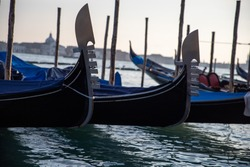 Gondolas moored outside St. Mark's Square in Venice Italy
