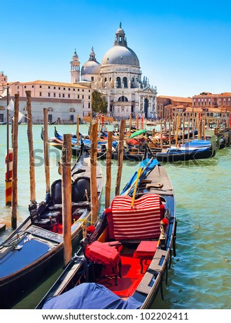 Gondolas on Canal Grande with Basilica di Santa Maria della Salute in the background in Venice, Italy