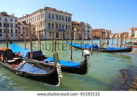 Gondolas on Grand Canal against old historic houses in Venice, Italy.