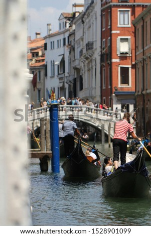 Gondolas on Grand Canal Venice surrounding by historical attractive building, Venice, Italy, Commercial advertisement for day trip boat in Europe #1528901099