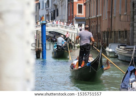 Gondolas on Grand Canal Venice surrounding by historical attractive building, Venice, Italy, Commercial advertisement for day trip boat in Europe #1535751557