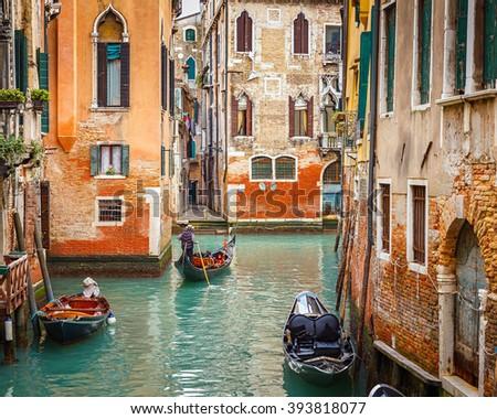 Gondolas on narrow canal in Venice, Italy #393818077
