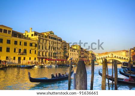 gondolas on the Grand Canal in Venice. Rialto Bridge on background. Sunset #91636661