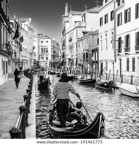 gondolas passing on small canal ...