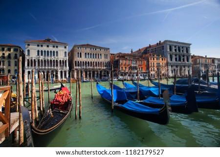 Gondolas pier row anchored on Canal Grande, Venice, Italy #1182179527
