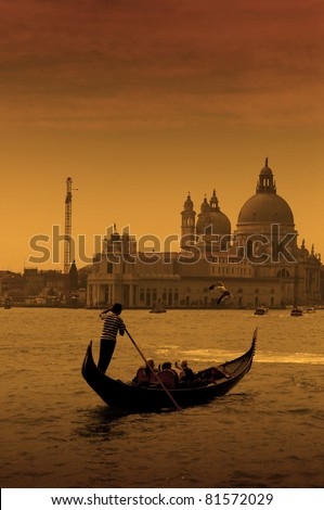 Gondolier at the dusk in Venice, Italy