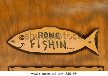 gone fishin...wood sign on door.