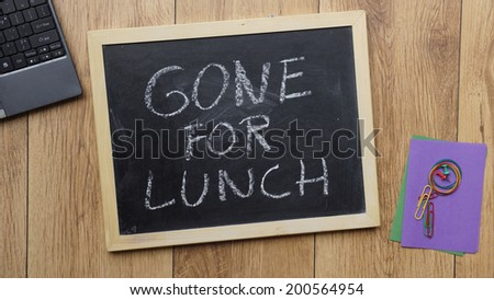 gone for lunch written on a
