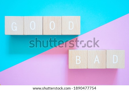 Good and Bad; Seven wooden blocks with GOOD BAD text of concept. Stockfoto ©