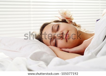 Good Caucasian woman Sleeping in bed on a light background