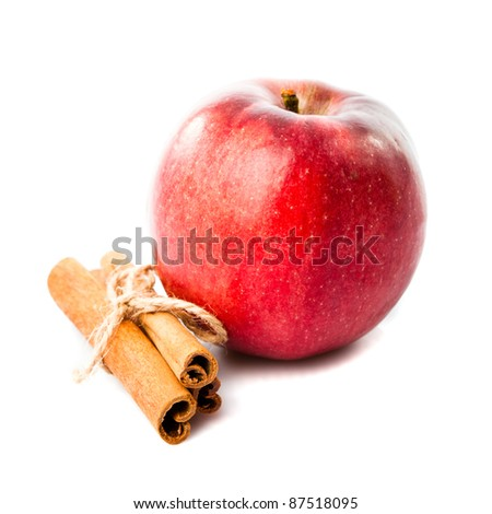 Good combination of apple and cinnamon isolated on white