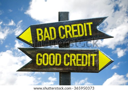 Good Credit - Bad Credit signpost with sky background