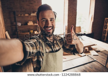 Good day mood build builder construction constructor engineer workman repairman concept. Close up photo portrait of cheerful glad handsome beaming toothy bearded guy make take selfie on smart phone