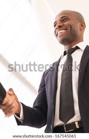 Good deal. Close-up of low angle view of business men shaking hands